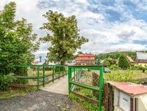 Green bridge to neighbourhood house Royalty Free Stock Images