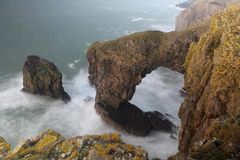 Green Bridge of Wales. The Green Bridge of Wales is a spectacular natural arch carved by the sea into the cliffs of the Pembrokeshire coast Royalty Free Stock Photos