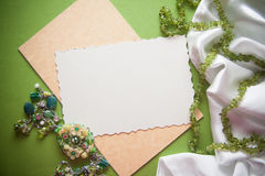 Green bright vintage background with beads and drapery Stock Images