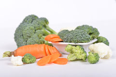 Green broccoli and carrot cut in pieces Stock Photography