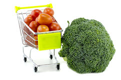 Green broccoli, cherry tomatoes on trolley. On white background Royalty Free Stock Image