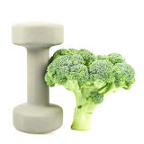 Green broccoli next to a dumbbell Royalty Free Stock Photography
