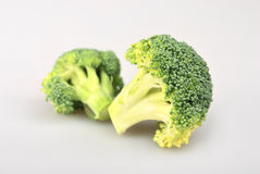 Green broccoli pieces. Two green broccoli cabbage pieces Royalty Free Stock Photos