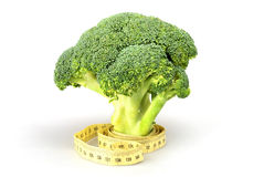 Green broccoli with tape measure Stock Photo