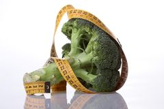 Green broccoli and tape measure Royalty Free Stock Images