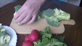 Green broccoli on wood table stock footage