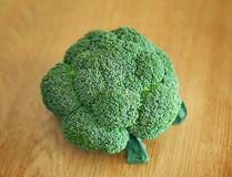 Green broccoli on wooden background Royalty Free Stock Image