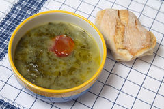 Green broth soup Stock Photos