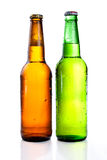 Green and brown beer bottle with drops. Drink without label on a white background Royalty Free Stock Photos