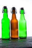 Green and brown beer bottles. Retro. Isolated Stock Image