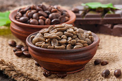 Green and brown coffee beans Stock Images