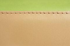 Green and brown leather. Natural green and brown leather background closeup Stock Photos