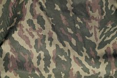 Green and brown military camouflage uniform pattern. Abstract background and texture for design Royalty Free Stock Photography