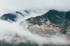 Green and Brown Mountains Covered of Clouds during Daytime Royalty Free Stock Photo
