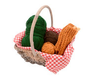 Green, brown and orange yarn with knitting in a basket Stock Images