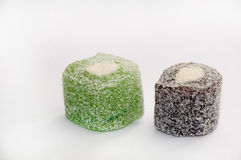 Green and brown turkish delight over white background Stock Image