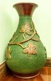 Green brown vase. Leaves on green brown vase Royalty Free Stock Images
