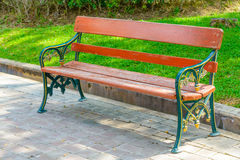 Green and brown wooden park bench Stock Images