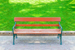 Green and brown wooden park bench Stock Image