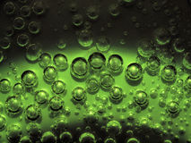 light and dark green bio bubbles on metalic background Royalty Free Stock Images