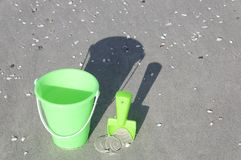 Green Bucket on a Beach Royalty Free Stock Photos
