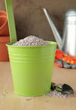 Green bucket with fertilizer Stock Image