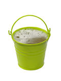 Green bucket with foaming liquid.Isolated. Royalty Free Stock Photos
