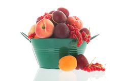 Green bucket fresh summer fruit Stock Photos