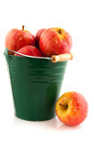 Green bucket with red apples Royalty Free Stock Photos