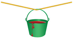 Green bucket with red paint Stock Images