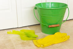Green Bucket and Yellow Gloves Stock Photo