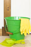Green Bucket and Yellow Gloves Stock Photos