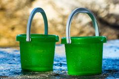 Green buckets on stone Royalty Free Stock Photography