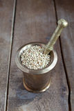 Green buckwheat in the old mortar and pestle Royalty Free Stock Photos
