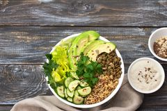 Green Buddha Bowl with lentils, quinoa, avocado, cucumber, fresh lettuce, herbs and seeds. Green Buddha Bowl with lentils, quinoa, avocado, cucumber,  with Stock Image