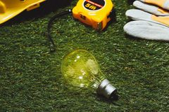 Green building and energy saving concept: house projecj and work tools on the grass.  stock photos