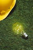 Green building and energy saving concept: house projecj and work tools on the grass.  stock images