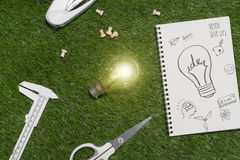 Green building and energy saving concept: house projecj and work tools on the grass.  royalty free stock photos