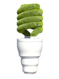 Green Bulb. Light bulb covered in green grass Royalty Free Stock Photo