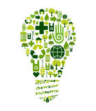 Green bulb with environmental icons. Green bulb silhouette made with environmental icons set Royalty Free Stock Photography