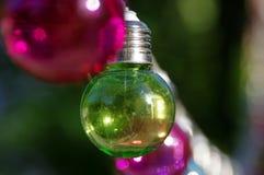 Green bulb. Green vitreous bulb on dark background Stock Images