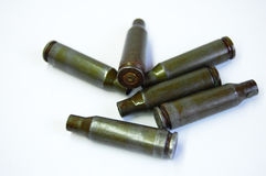 Green bullets and casings from Kalashnikov automatic rifle at white background Royalty Free Stock Photo