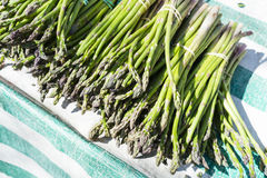 Green bunches of asparagus in a market in Paris, France royalty free stock photography