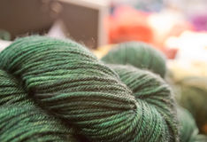 Green bundles of wool yarn Royalty Free Stock Photos