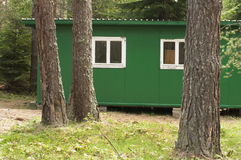 Green bungalow in the forest Stock Image
