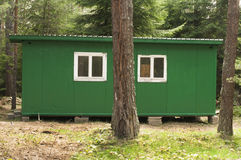 Green bungalow in the forest Stock Photos