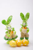 Green bunnies couple with eggs Stock Photography