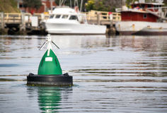Green buoy. Floating in water as a current marker Royalty Free Stock Photo