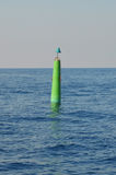 Green buoy floats sea. Green buoy floats in the sea Royalty Free Stock Photos