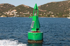 Green buoy with solar battery, canal border mark Stock Photography